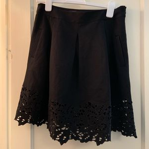 Black Pleated Skirt with Cutouts and Pockets